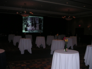 A 9' x 12' rear projection screen played a custom designed retrospective of our high school days throughout the evenin