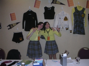 Lauren and Lindsy model the old uniform. Behind them are more original high school fashions.